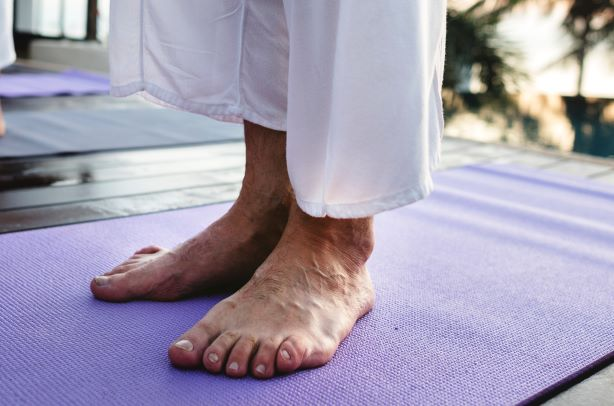 How can Psoriatic Arthritis affect the feet?